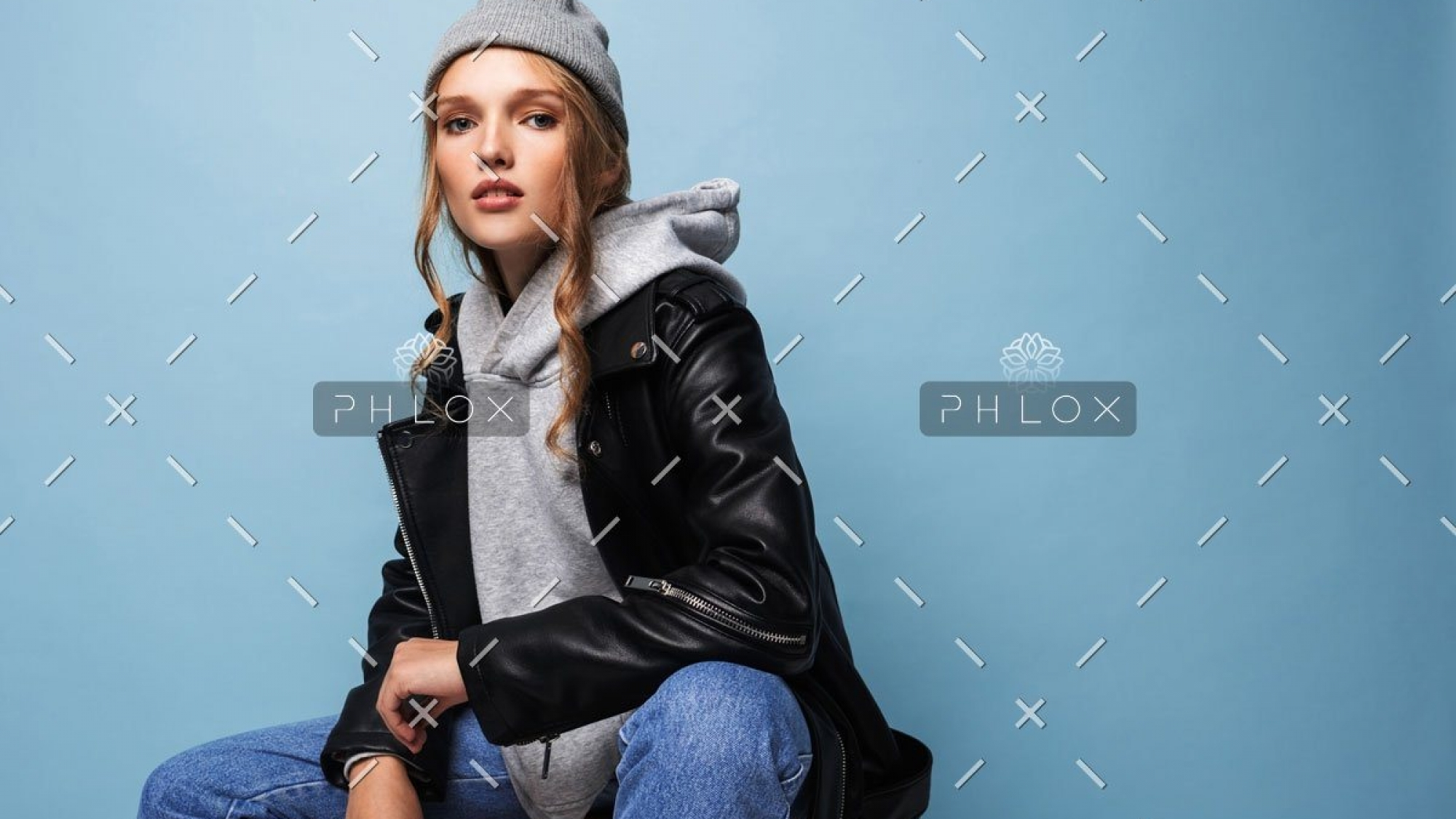 demo-attachment-404-young-beautiful-woman-with-wavy-hair-in-gray-hat-W8LUZM3