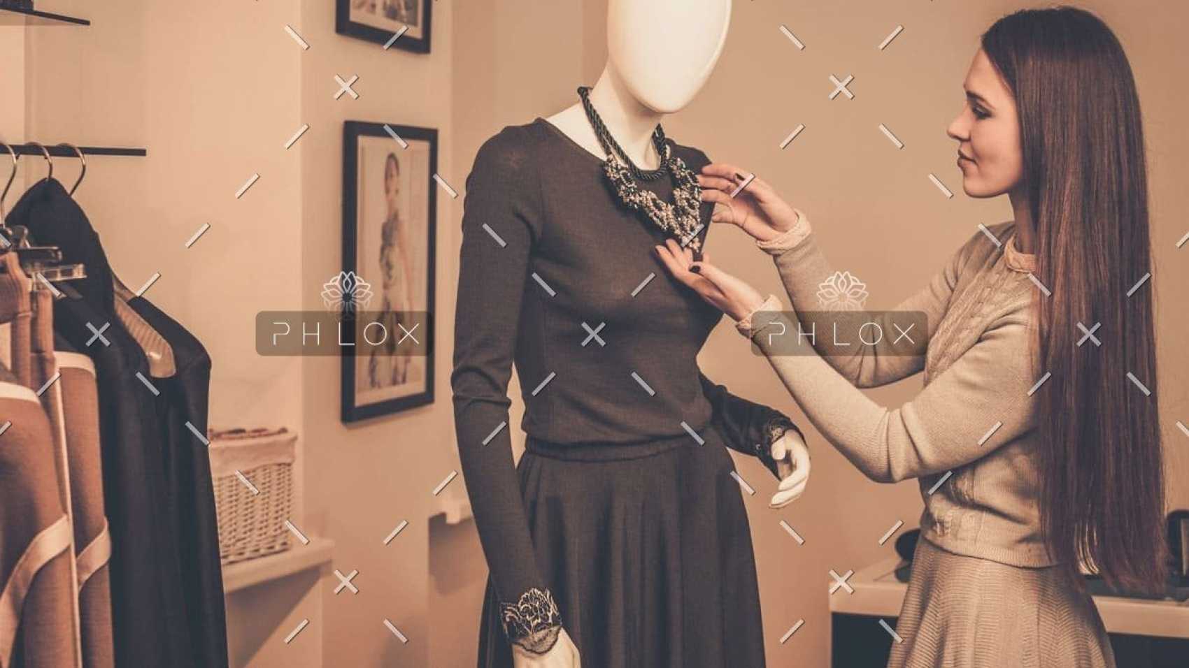 demo-attachment-955-young-woman-looking-at-necklace-on-mannequin-in-PSQQMMH-1